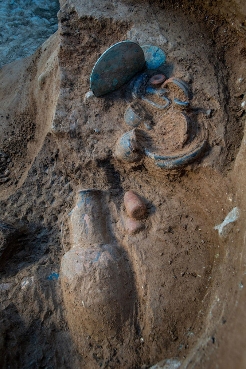 Pottery shreds, bronze artefacts and a mirror found during excavation works in the Etruscan tomb in Corsica. Photo Credit: Inrap.