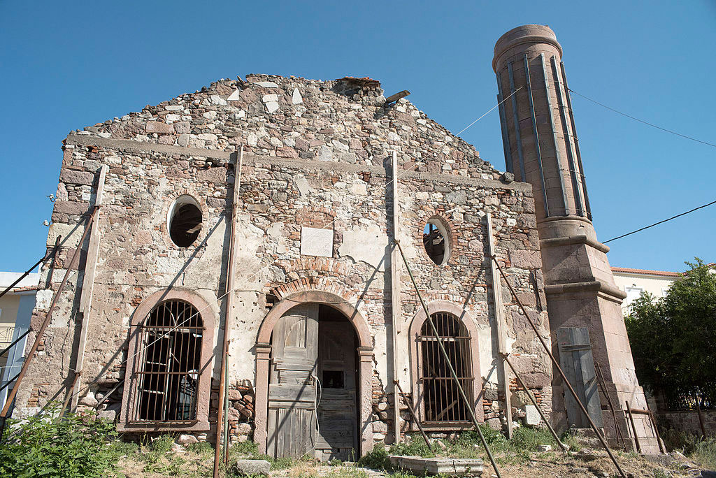 The Valide Djami is a one storey stone building with a pitched roof most of which has collapsed.