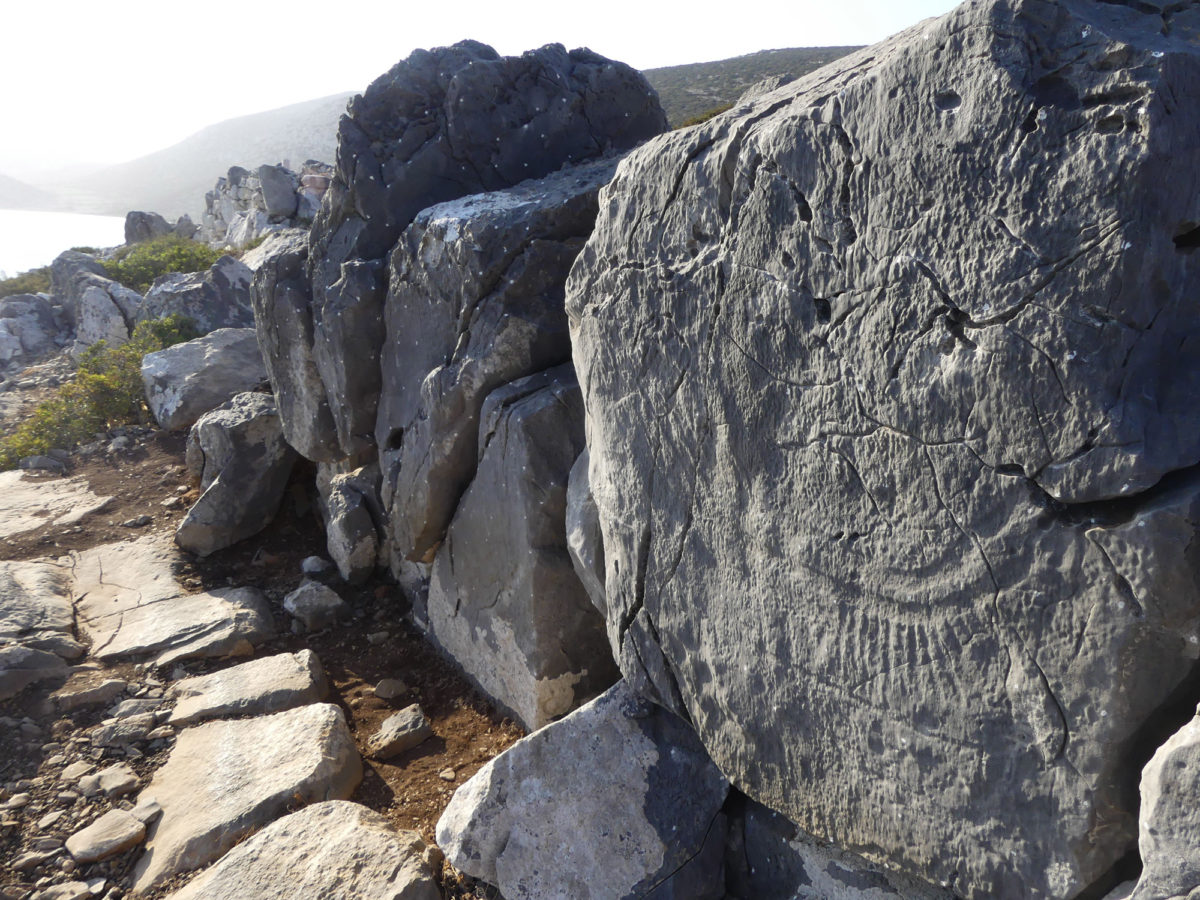 Rock carvings of ships on the acropolis.