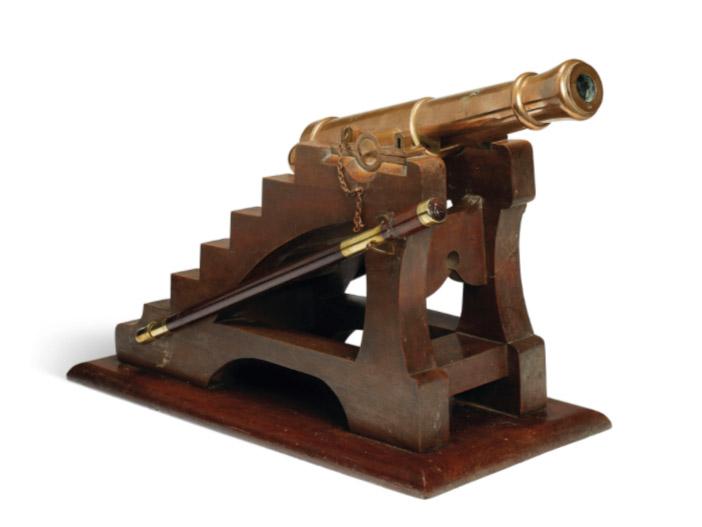 Miniature replica of the Eiffel Tower cannon.