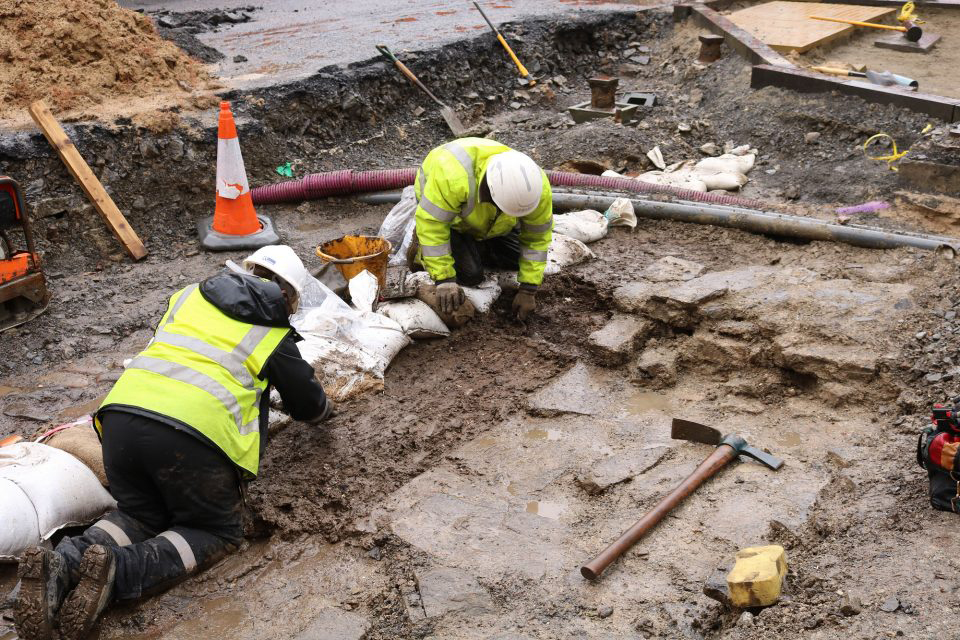 The ORCA Archaeology team working in challenging weather conditions at the site. Photo: ORCA Archaeology.