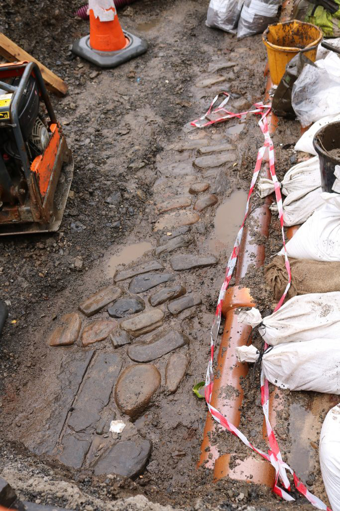 Cobbled surface unearthed in Castle Street Orkney. Photo: ORCA Archaeology.
