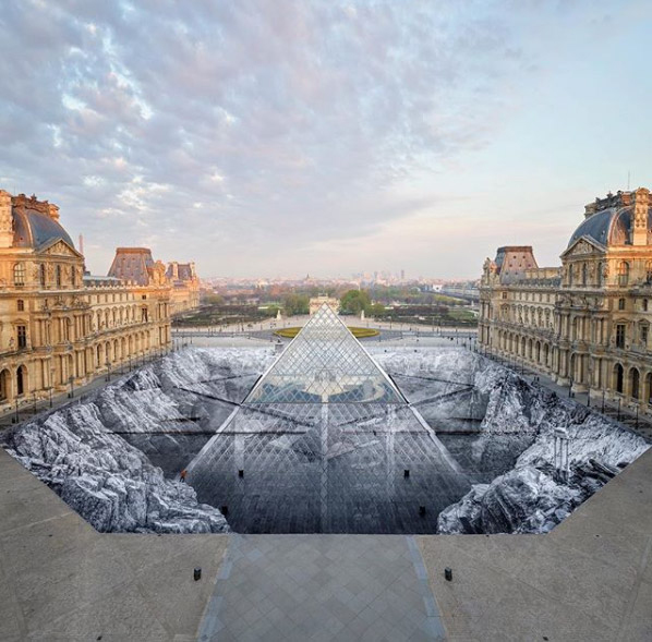With the help of 400 volunteers, JR created a 17,000 square metre optical illusion in the courtyard. Photo: JR.