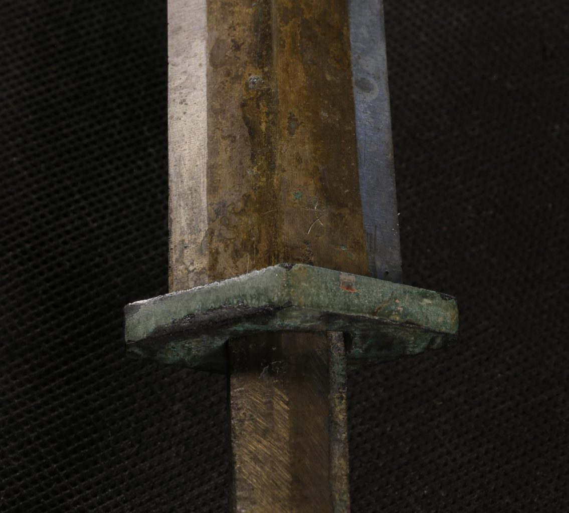 Detail from the grip and blade from one of the Terracotta Army swords. In most of the swords analysed, the highest concentrations of chromium are detected in the guard and other fittings, which would have been in contact with the lacquered organic parts. Credit: Zhao Zhen