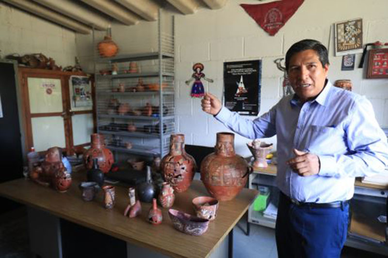 Jose Ochatoma, lead researcher at Wari complex,, said 45 ceramics have been restored and studied.   Photo Credit: Andina.
