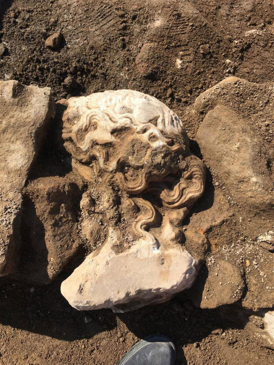 The head was found face down as part of a wall. Probably it was used as recycled building material. Photo Credit: Sovritendenza Capitlina/The History Blog.