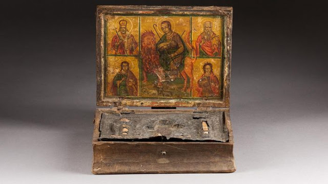 The case is made of wood and leather and contains relics from several saints.  Credit: CNA, Hargehseimer Auction House