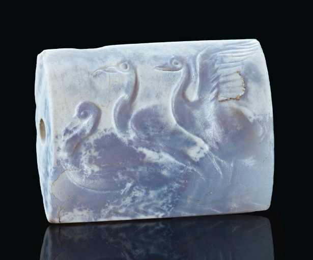 Minoan blue chalcedony tabloid seal with three swans, Late Palace Period, circa 16th cent. BC. Credit: © 2019 Christie's Image Ltd.