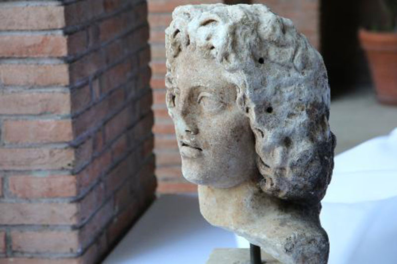 The Roman bust dates to the 2nd century AD and depicts a young man. Photo Credit: Ministero per i beni e le attività culturali/The Local.
