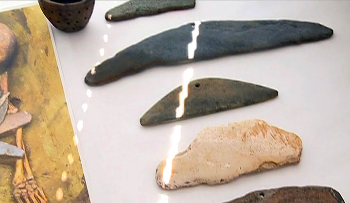 The crescent-shaped stones comprising a pendant were probably used for ritual purposes. Photo Credit: Institute of Archeology and Ethnography / The Siberian Times.