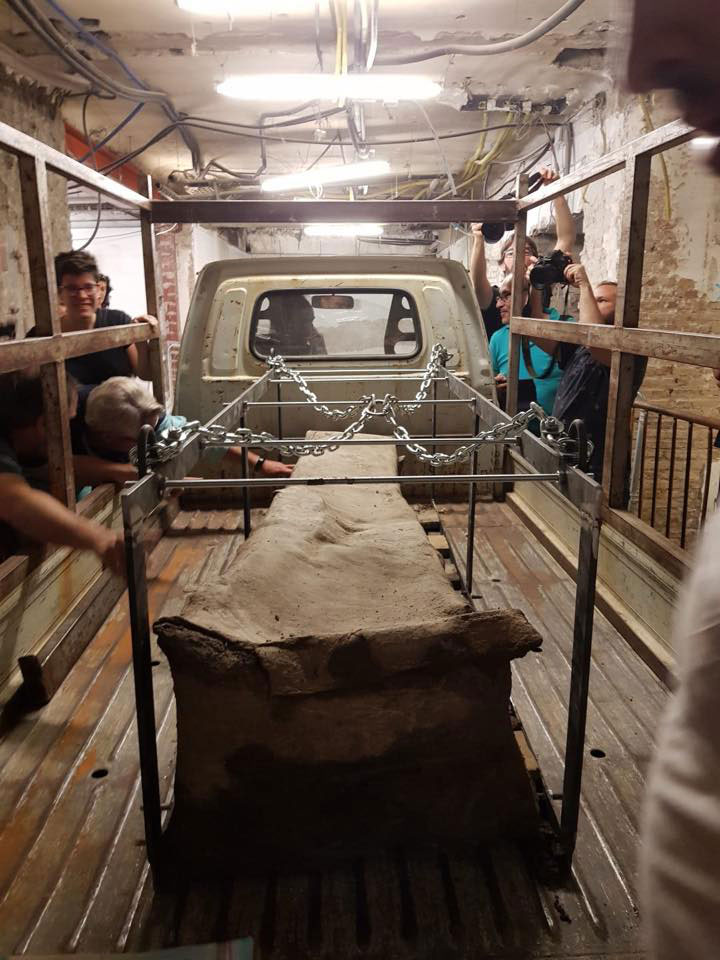 The sarcophagus is loaded on the back of a truck. Photo Credit: Gespad Al-Andalus Archaeology/The History Blog.