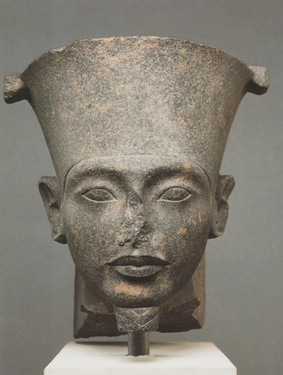 The brown quartzite head represents god Amen but the features are those of Tutankhamun. Photo Credit: Christie's.