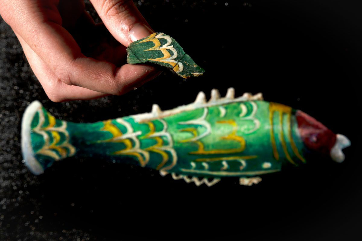 Fragment above artist's impression of how the fish bottle would have looked. © National Trust / Rod Kirkpatrick / F Stop Press