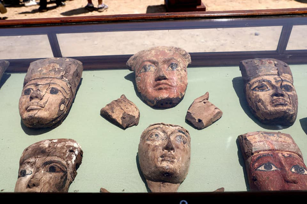 Remains of coffins skillfully carved with the faces of teh deceased.