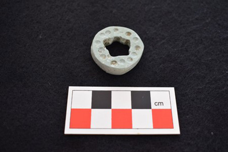 A unique picrolite stone disc pendant is evidence of a new material culture which accompanied the Middle Cypriot period reconfiguration. Photo Credit: Ministry of Interior, Cyprus.