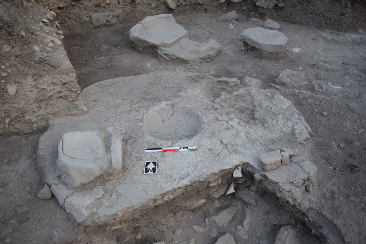 Chalcolithic house with hearth, basin and tools.