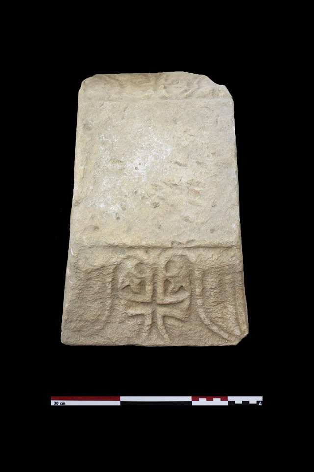 Marble lid with cross from the east end of the basilica's north aisle (photo: MOCAS)