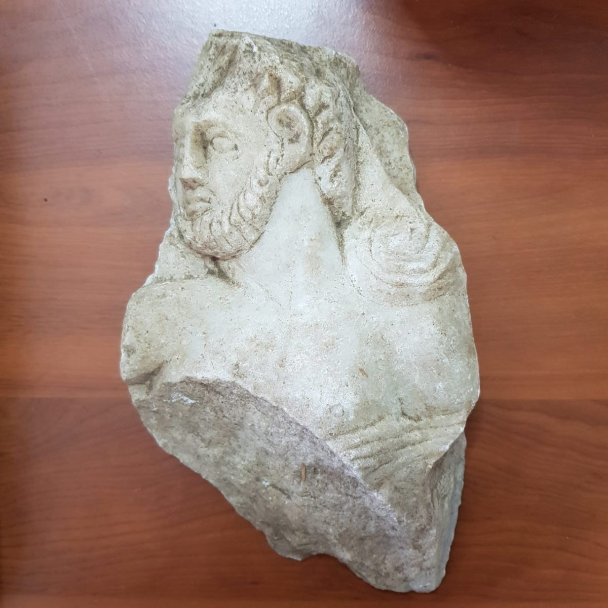 Part of a marble relief depicting a bearded man (photo: Hellenic Police)