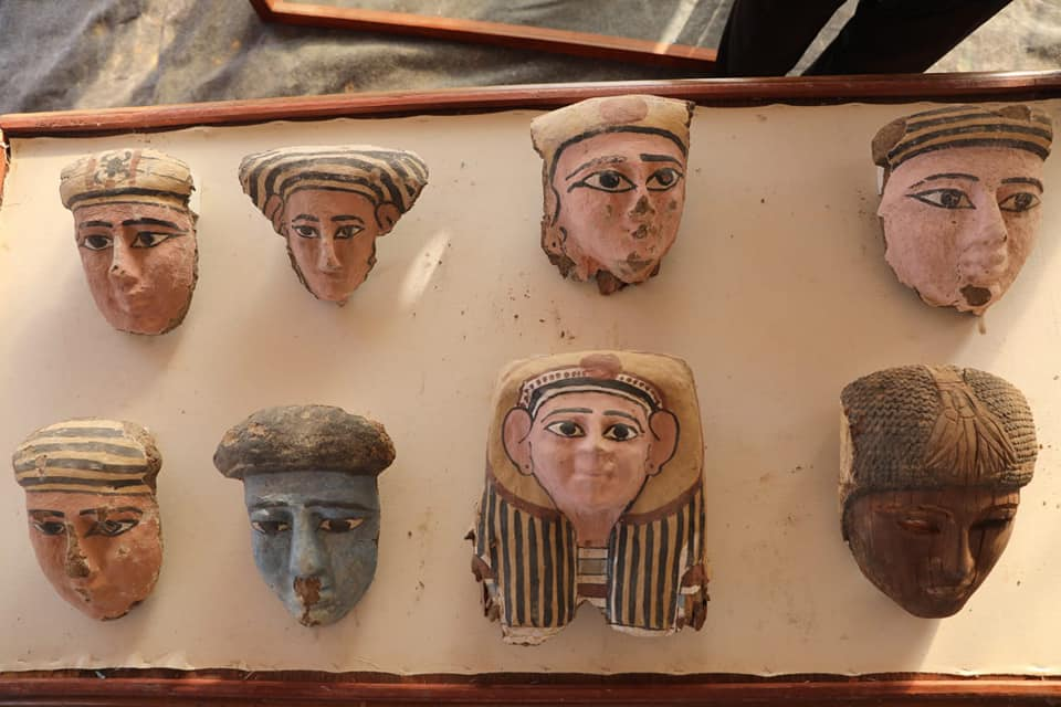 Wooden and clay mummy masks.