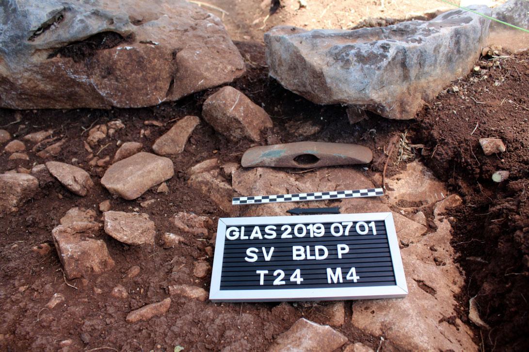 """Building """"P"""". Bronze axe in situ (photo: MOCAS)."""