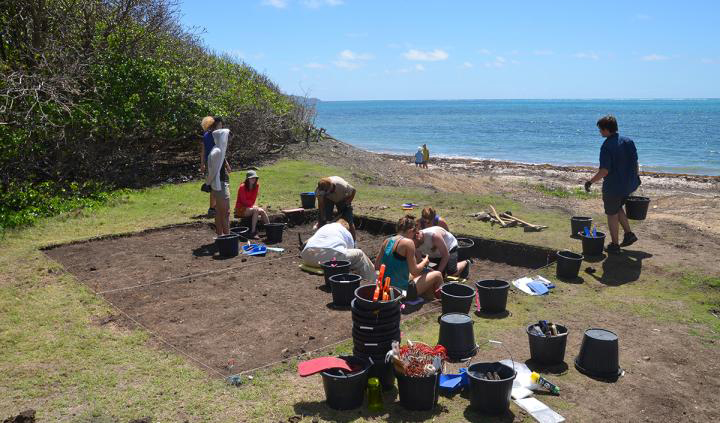 Students from the University of Oregon, North Carolina State University and University College London work at a Grand Bay cultural site on Carriacou Island, located in the Grenada Grenadines in the Lesser Antilles. Credit:  Photo by Scott Fitzpatrick