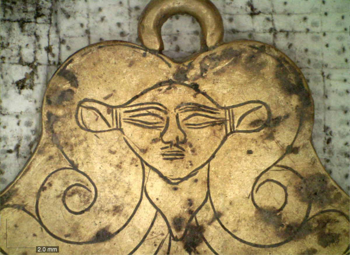 UC archaeologists found a gold pendant in the family tombs at Pylos featuring the likeness of Hathor, an Egyptian goddess who was a protector of the dead. Photo/UC Classics