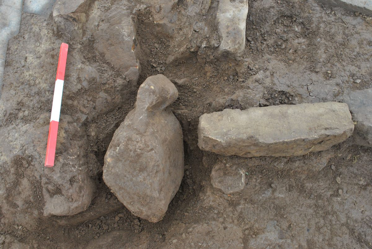 One of the figurines in situ next to the hearth. Credit: ORCA Archaeology