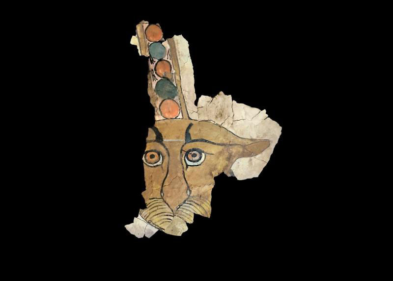 Figure of a leopard's head; painting in stucco on wood.