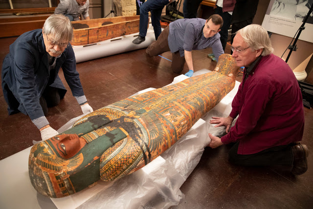 Dennis Piechota (from left), Adam Middleton, and Joe Green work on the coffin of Ankh-Khonsu
