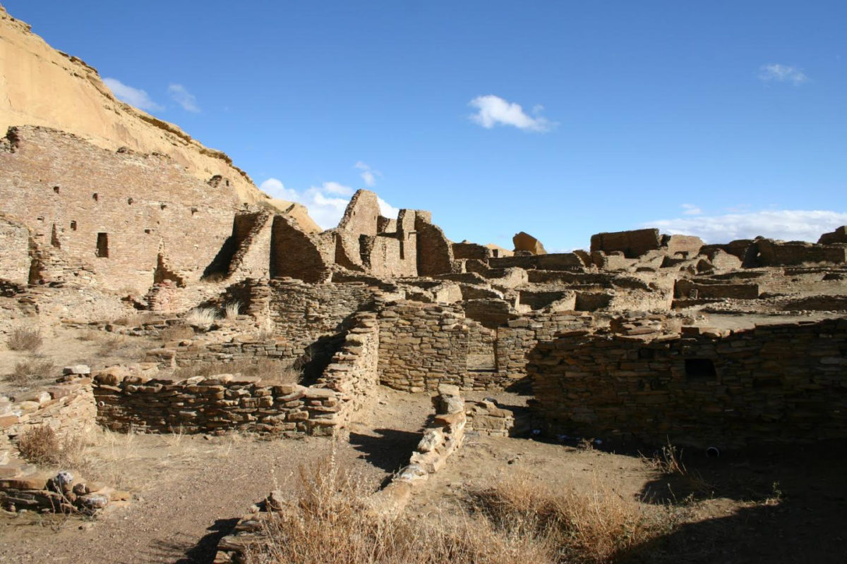 The north wall and room block of Pueblo Bonito, the largest of the great houses in Chaco Canyon. Pueblo Bonito is considered widely as the center of the Chaco world. Credit:  Thomas Swetnam
