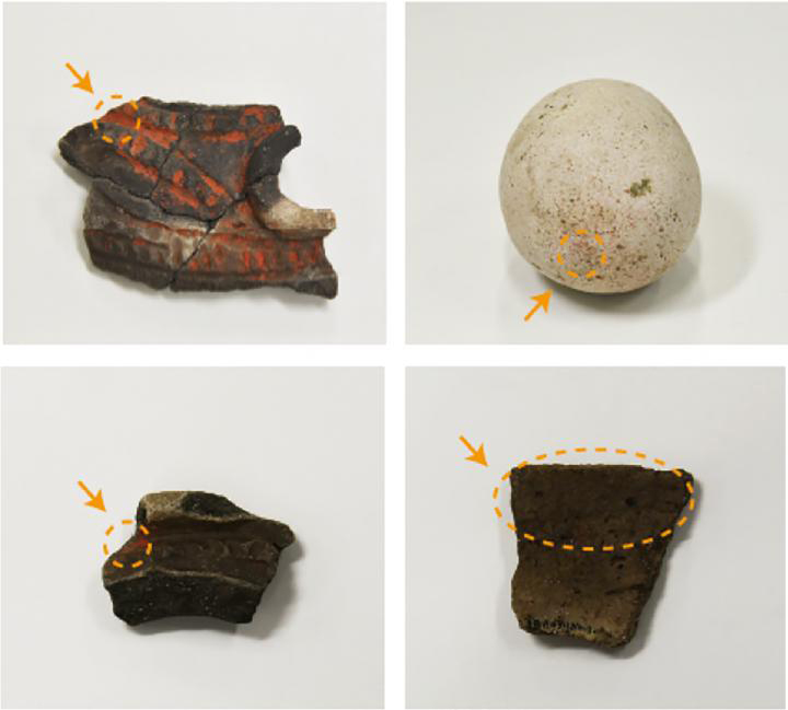 Artifacts from Kyoden that were sampled for vermilion using sulfur-free adhesive tape. (top and bottom left) Earthenware fragments. (top right) Stone tool. (bottom right) Potsherd. Arrows point to the sampled locations. Credit: RIKEN