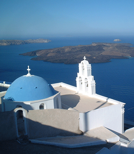 Modern buildings on the Greek island of Santorini overlook the caldera formed by an ancient, massive volcanic eruption.