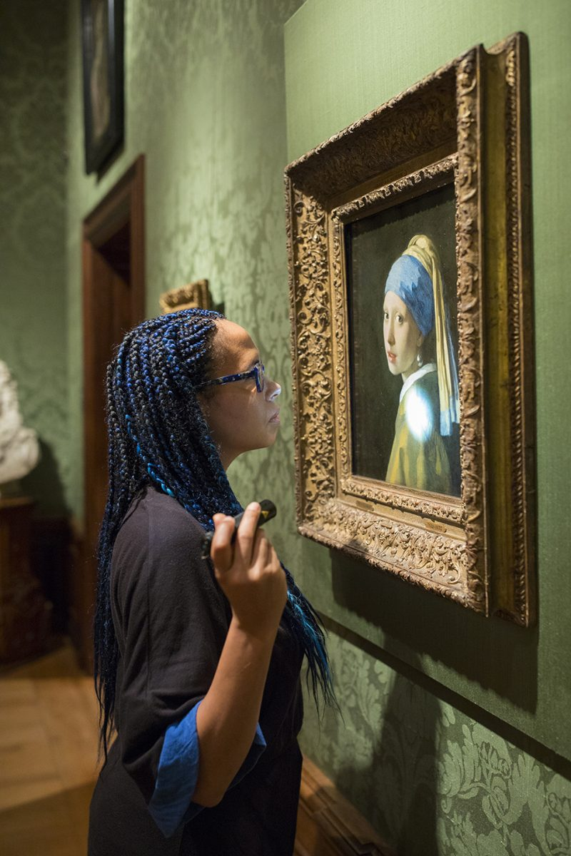 Abbie Vandivere, head of research team, in front of Vermeer's masterpiece.