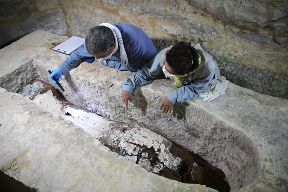 Revealing a coffin at the Mummification Workshop Complex in Saqqara.