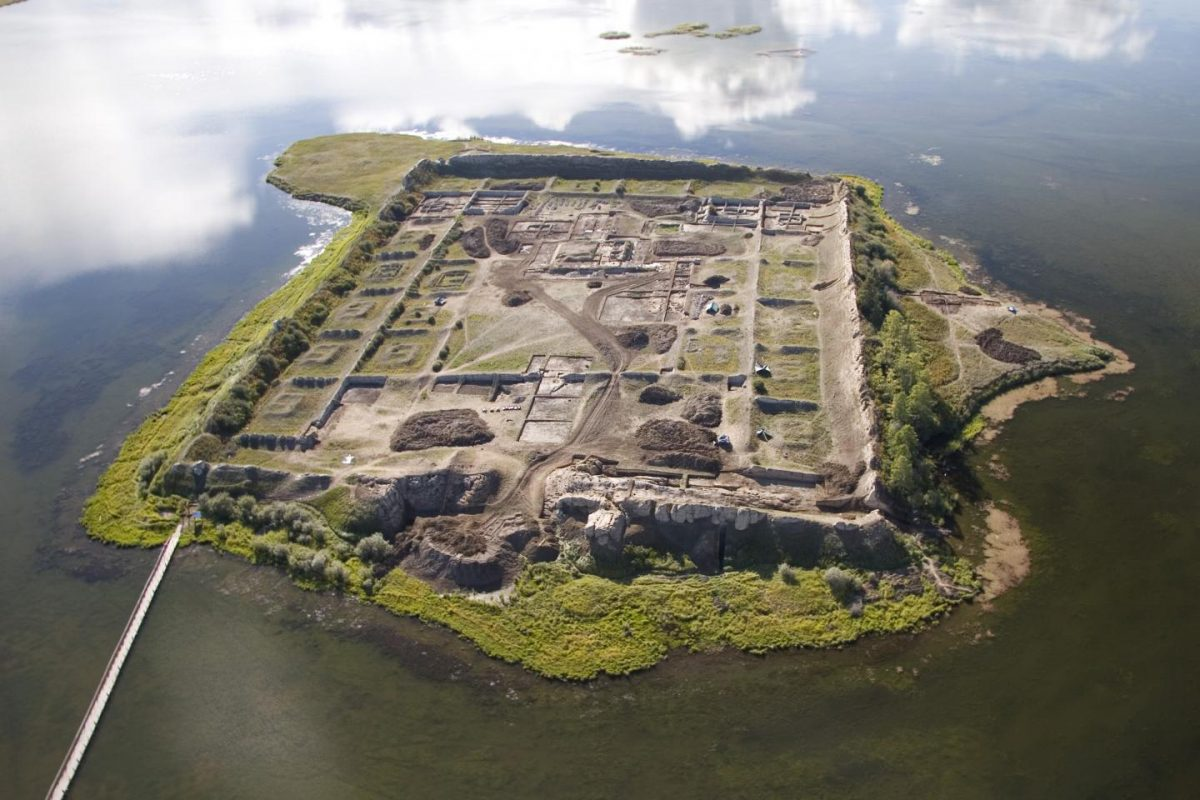 Aerial view of Por-Bajin from the west. The complex is situated on an island in a lake. Scientists have pinned its construction on the year 777 CE, using a special carbon-14 dating technique, based on sudden spikes in the carbon-14 concentration. Credit: Andrei Panin