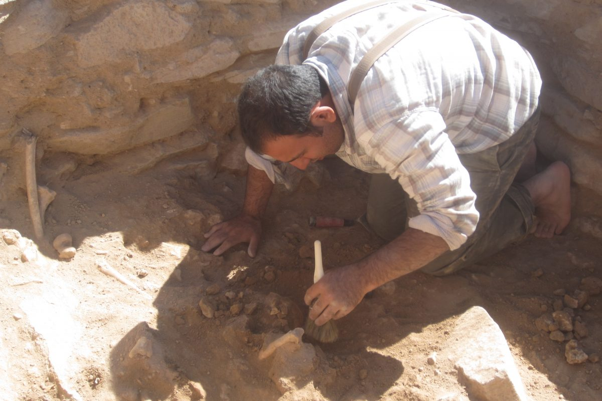 Siavash Samei '19 Ph.D. excavating one of the graves in the historic Kura-Araxas settlement in Mesopotamia, near the Iran border. (Photo credit: Karim Alizadeh)