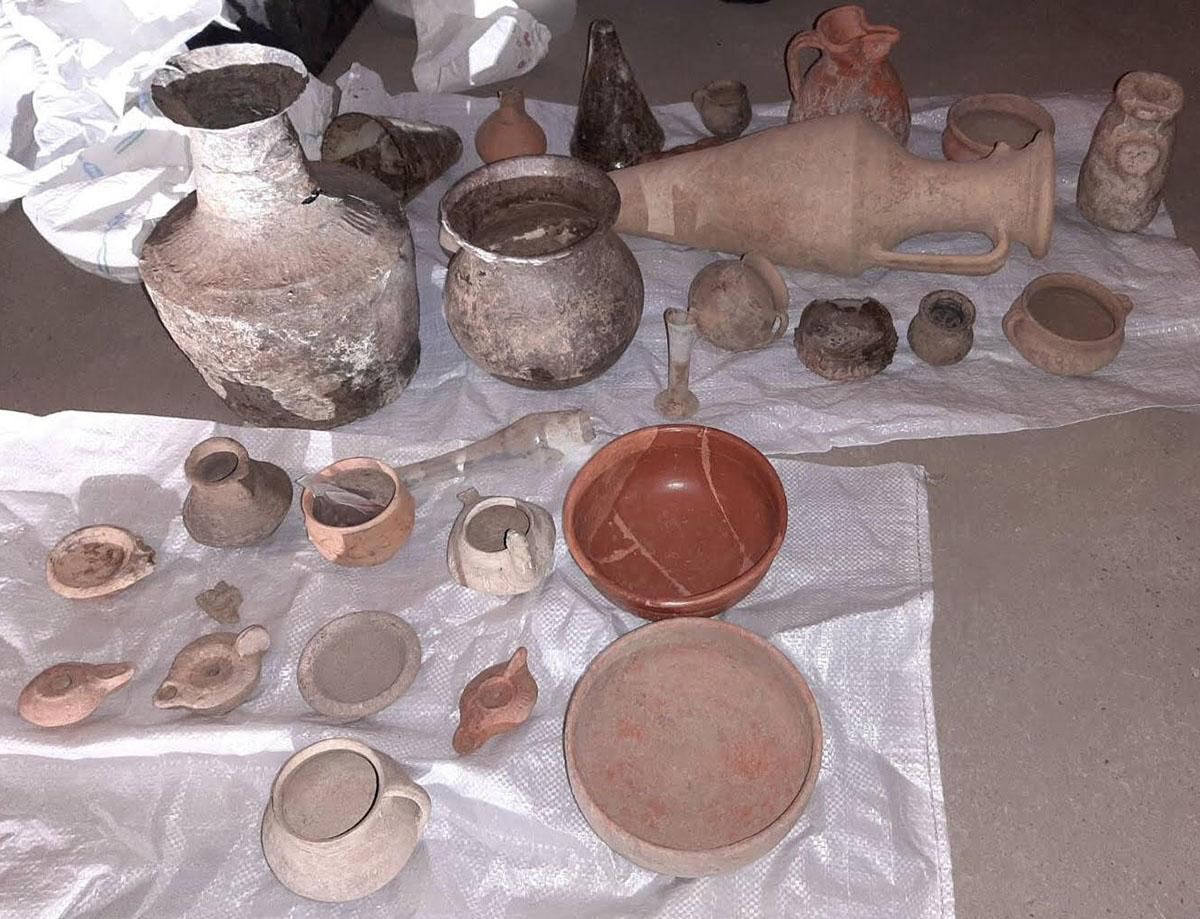 Among the trafficked items were ceramics, glass funeral urns, lamps, arrowheads, spears and ancient coins.