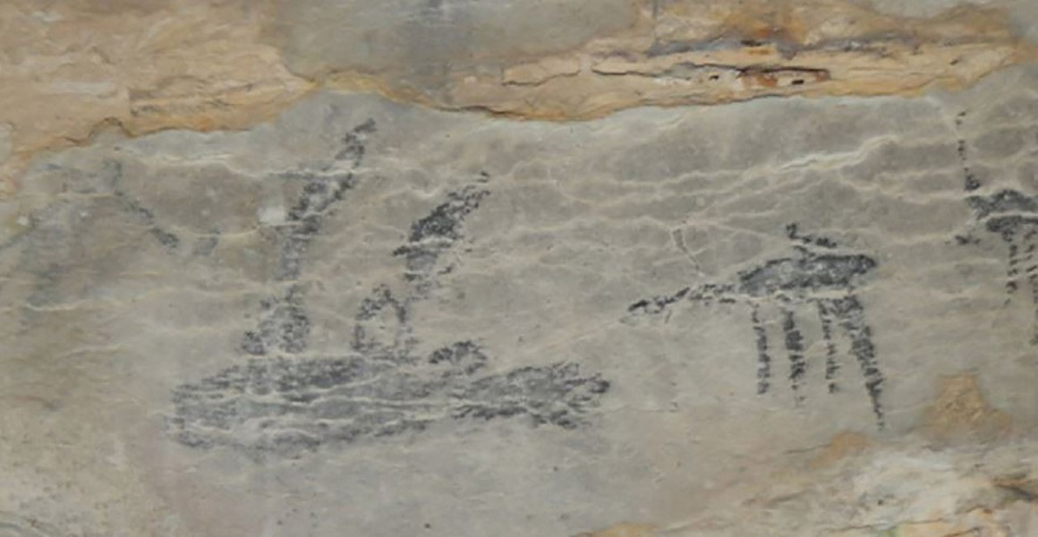 The cave art showing the only known image of a giant sloth lemur, in a hunting scene with dogs to the right. (Credit: © Burney et al. 2020)