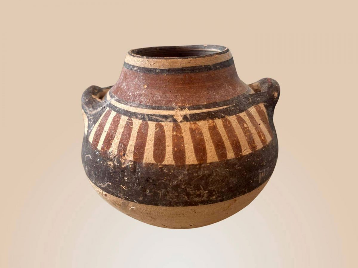 Bichrome ware miniature clay jar (approx. 6 cm high) dating to the Cypro-Archaic I period (750 – 600 BC).