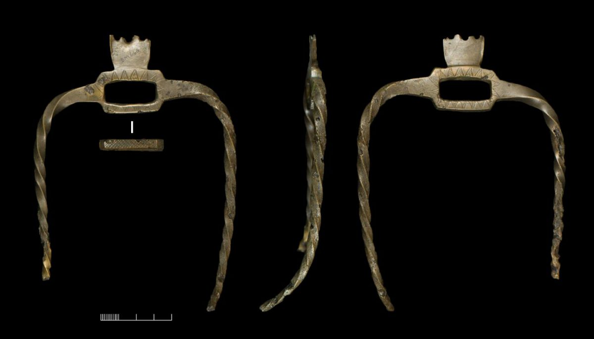 Unique Pronged Bronze Object from the Wilsford G58 burial found alongside the human bone musical instrument. Credit:  Wiltshire Museum, copyright University of Birmingham/David Bukachit