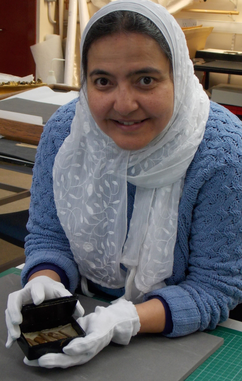 Abeer Eladany with the box. Photo credit: University of Aberdeen.