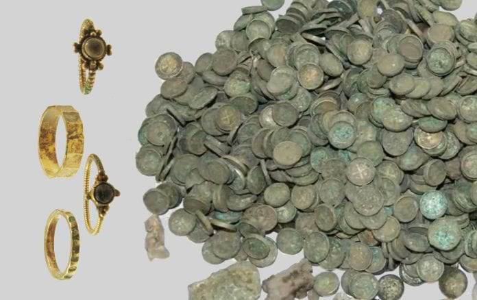 6,500 silver coins arranged in linen pouches, silver ingots, two gold rings, and two wedding bands. Image Credit : Institute of Archaeology and Anthropology of the Polish Academy of Sciences