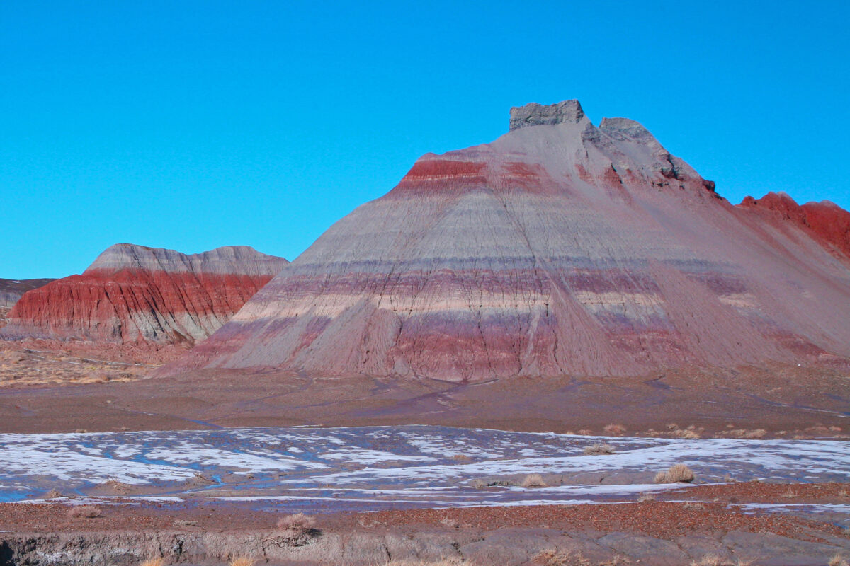 The colorful banded Tepees are part of the Blue Mesa Member, a geological feature about 220 million to 225 million years old in the Chinle Formation in Petrified Forest National Park in Arizona. Photo: NPS