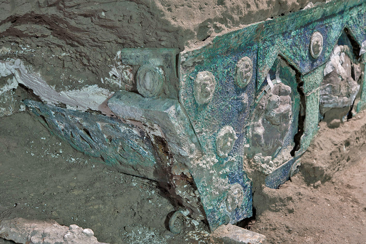 The large ceremonial chariot with four wheels was found along with its iron components (Credit: MiBACT - Luigi Spina).