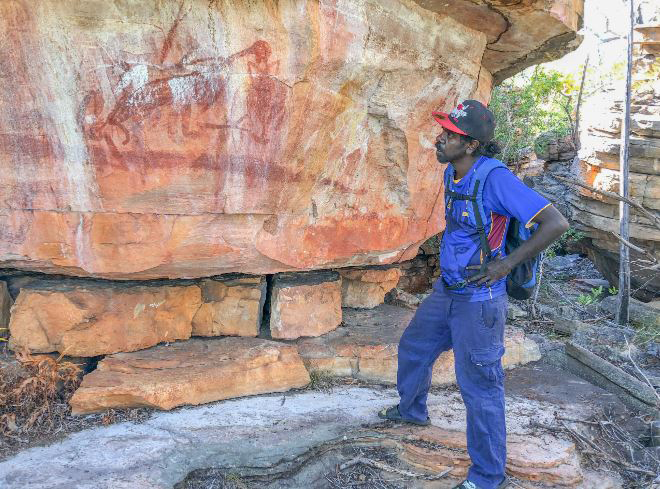 Young Dakal clan landowner Desmond Lindsay visits this site on his country for the first time. Most sites are remote and often impossible to even approach closely by vehicle. Photo: Mimal Land Management Aboriginal Corporation (MLMAC).