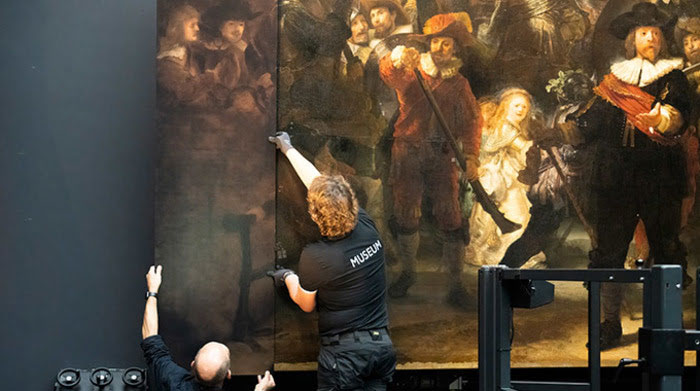 The Night Watch gets its missing pieces back. Photo via the Rijksmuseum.