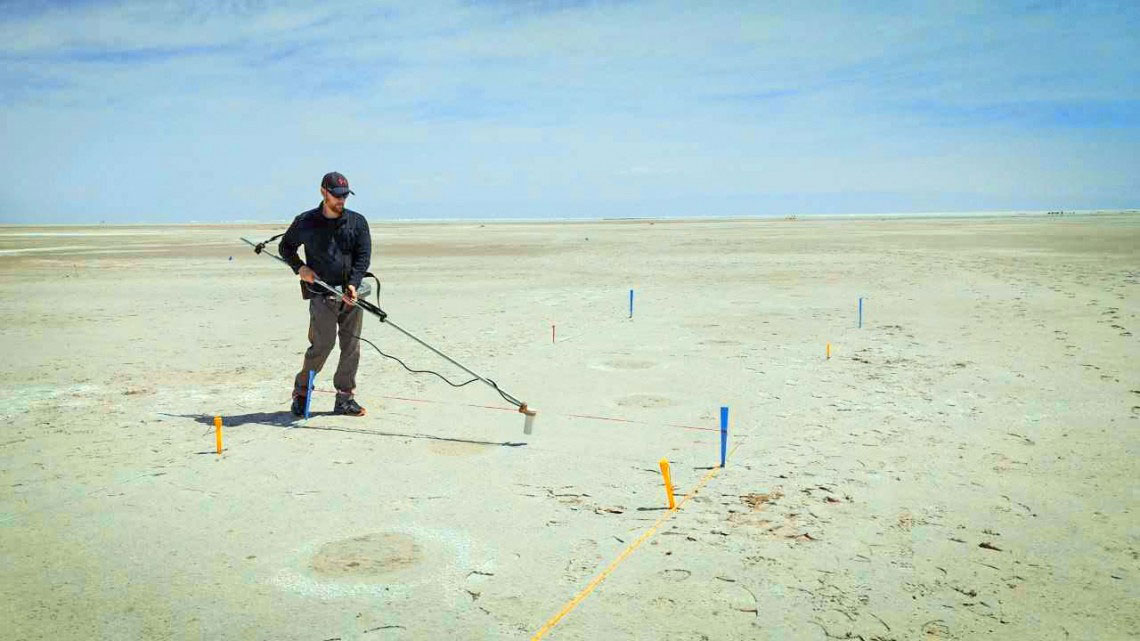 Thomas Urban conducts magnetometer survey of mammoth footprints at White Sands.
