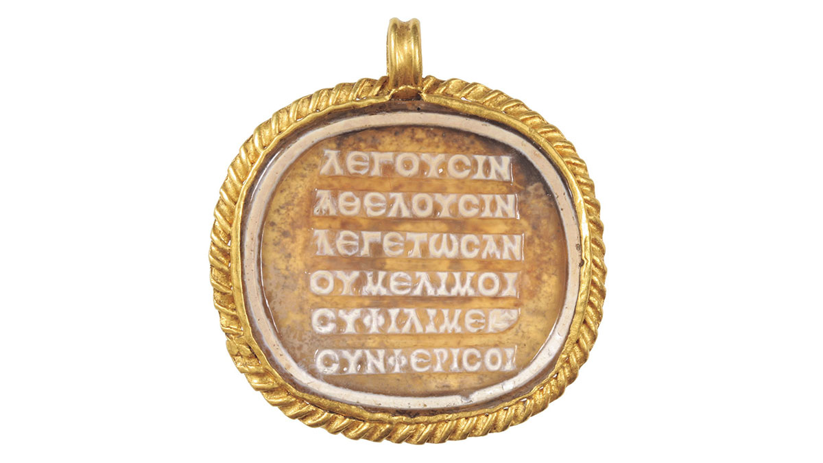 The poem inscribed on a cameo on a medallion of glass paste (2nd to 3rd century CE) found in a sarcophagus around the neck of a deceased young woman in what is now Hungary. Image courtesy of Aquincum Museum