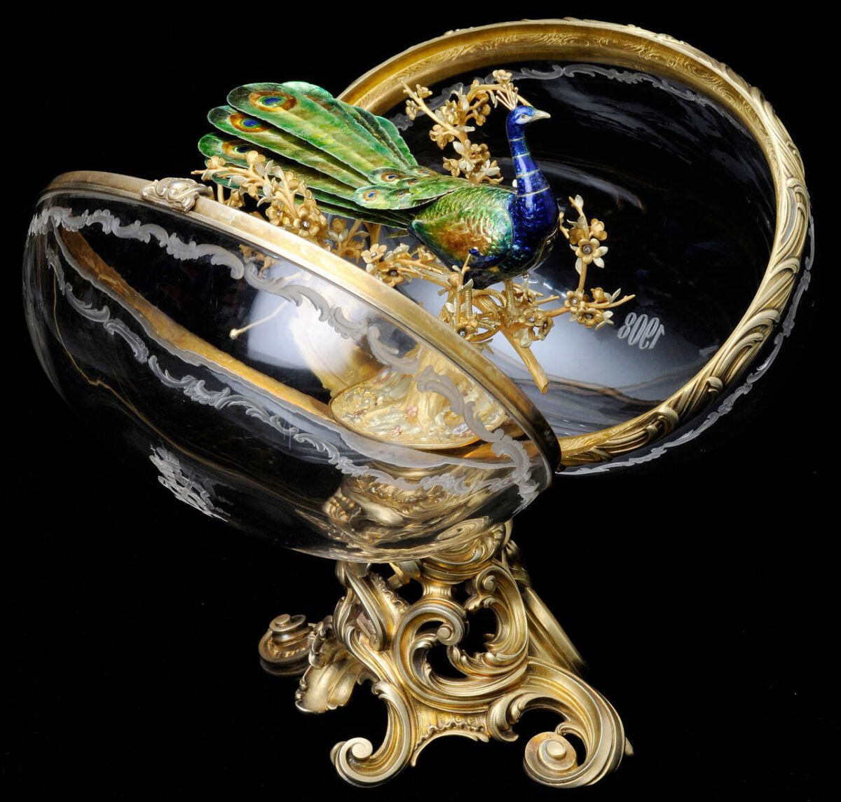 """""""The Peacock Egg"""", the crystal egg concealing inside it a mechanical enameled gold peacock (source: V&A Museum)."""