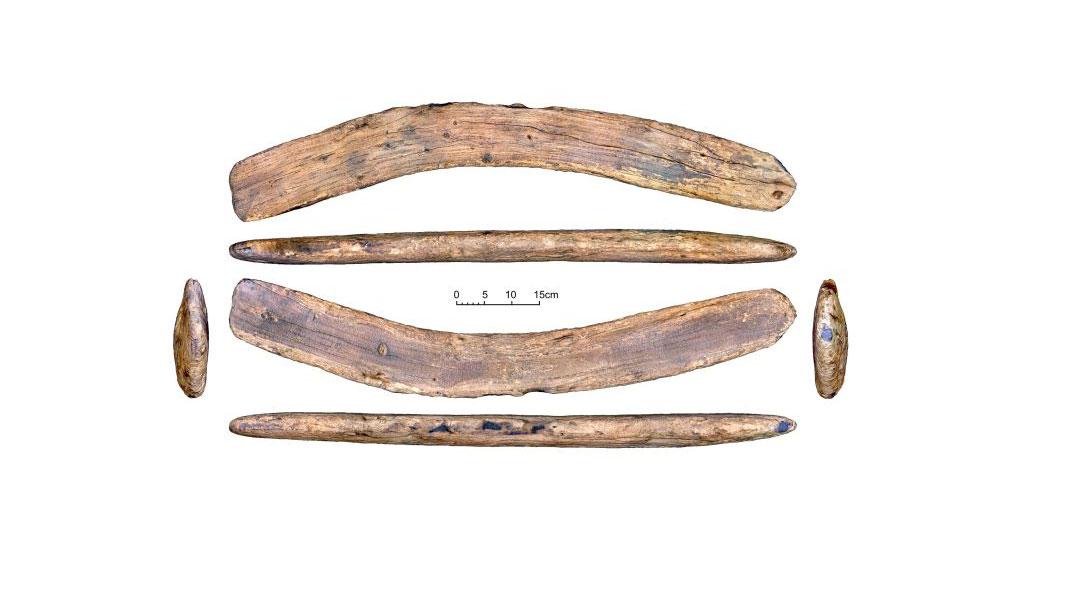 Easter Island glyphs on boomerang-shaped wood